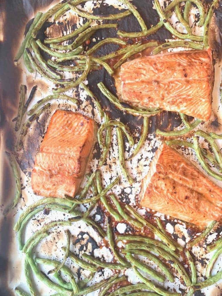 sheet pan miso boiled salmon and green beans on parchment paper