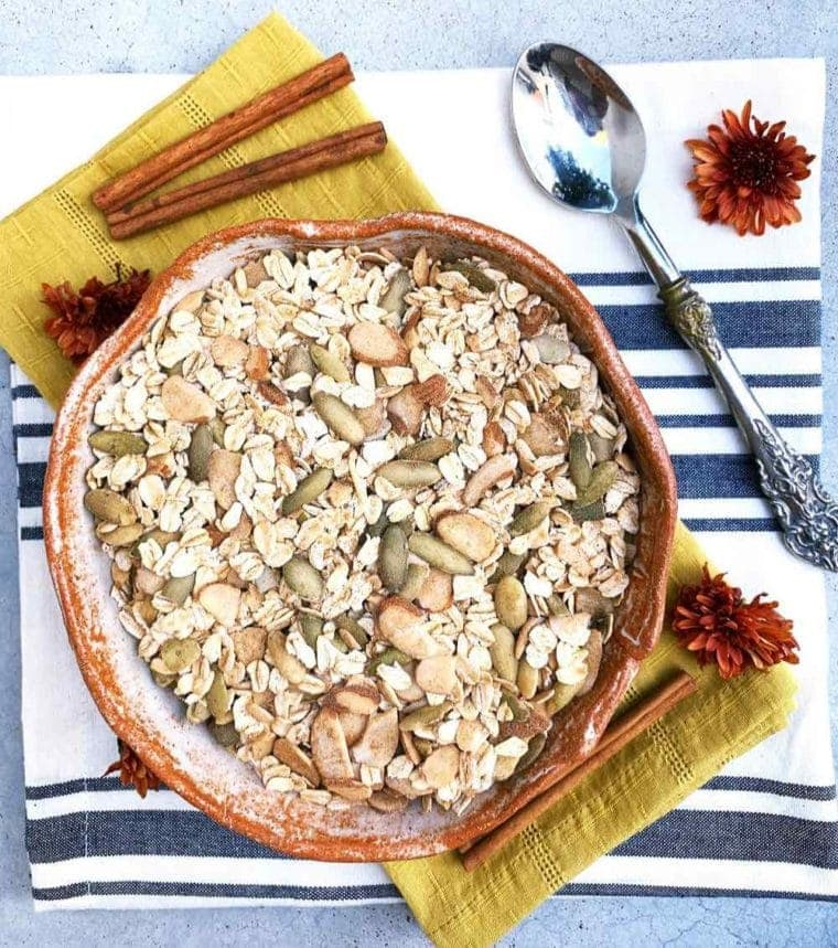 chai spiced gluten free muesli in a pretty farmhouse pottery bowl.