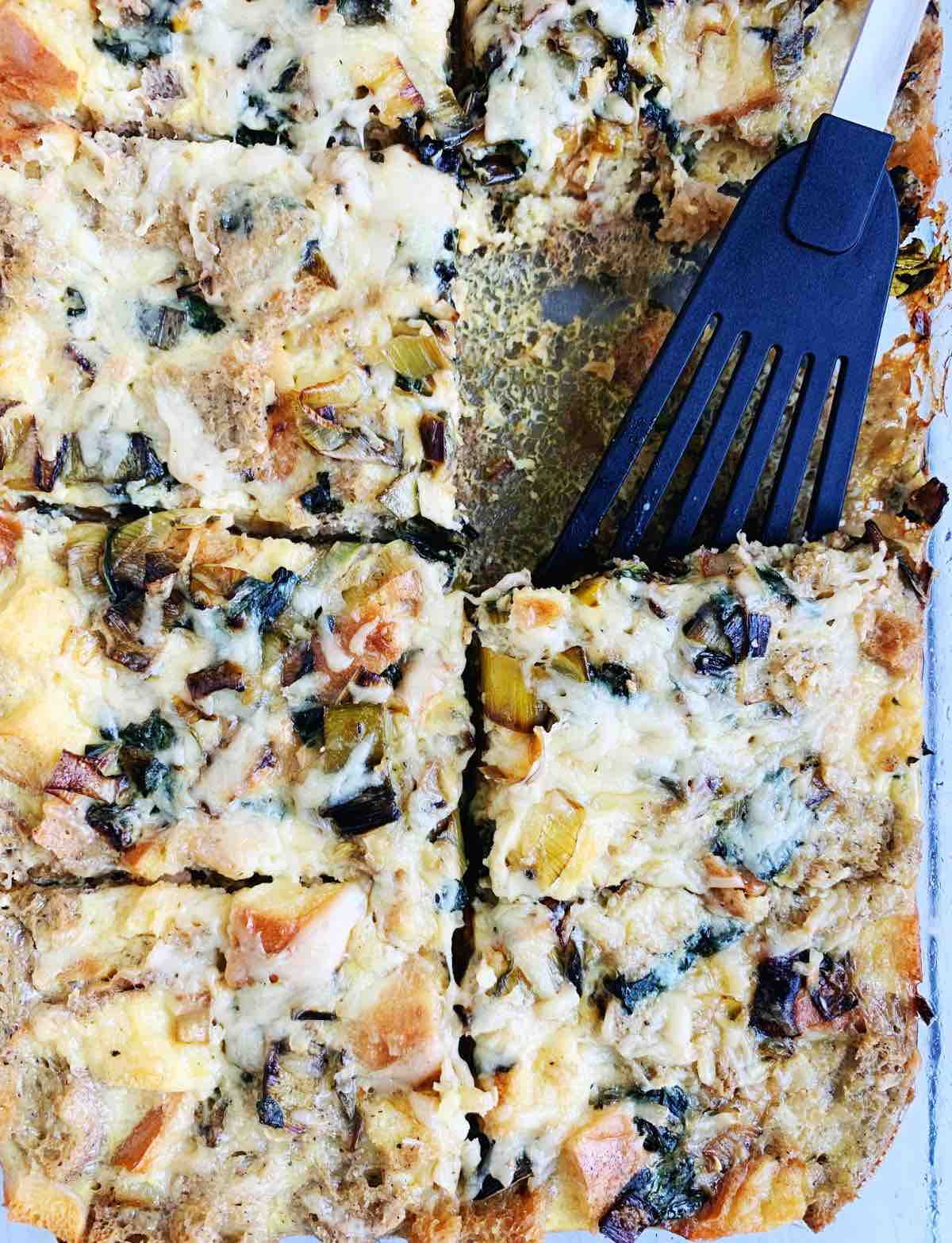 Gluten Free Breakfast Casserole with a black spatula for serving.