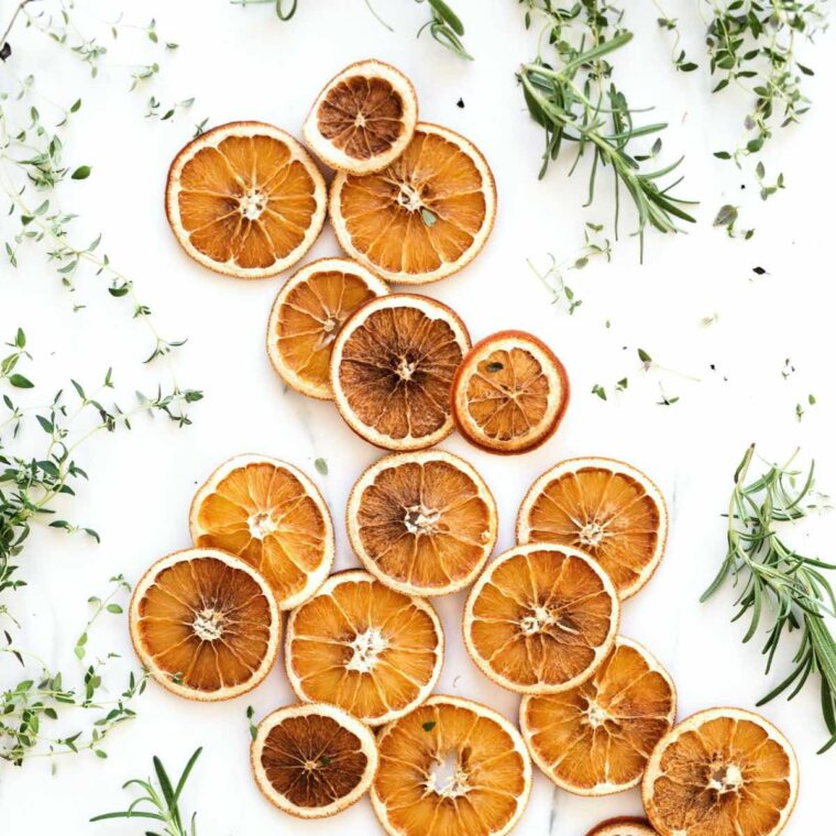 improve digestion naturally- oranges and fresh herbs.