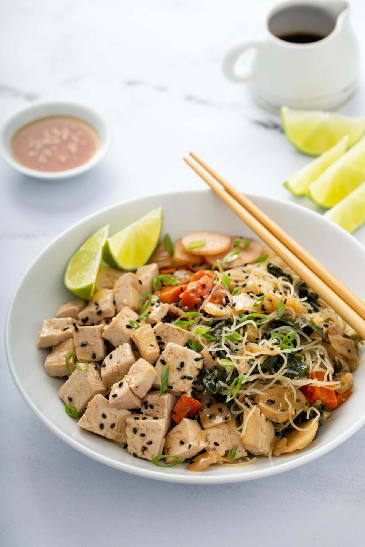 Low FODMAP Meal Delivery Chicken Power Bowl with vegetables and chopsticks.