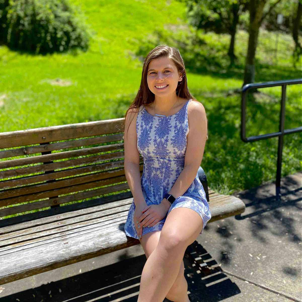 Photo of Carly Waldman sitting on a bench.