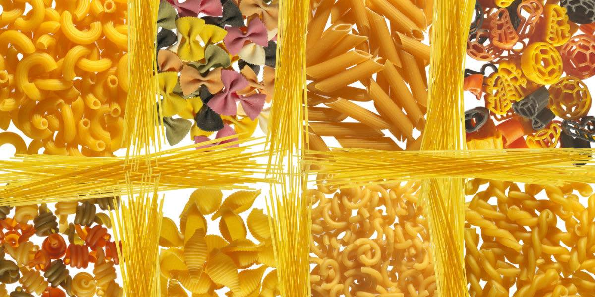 variety of different dry gluten free pasta shapes.