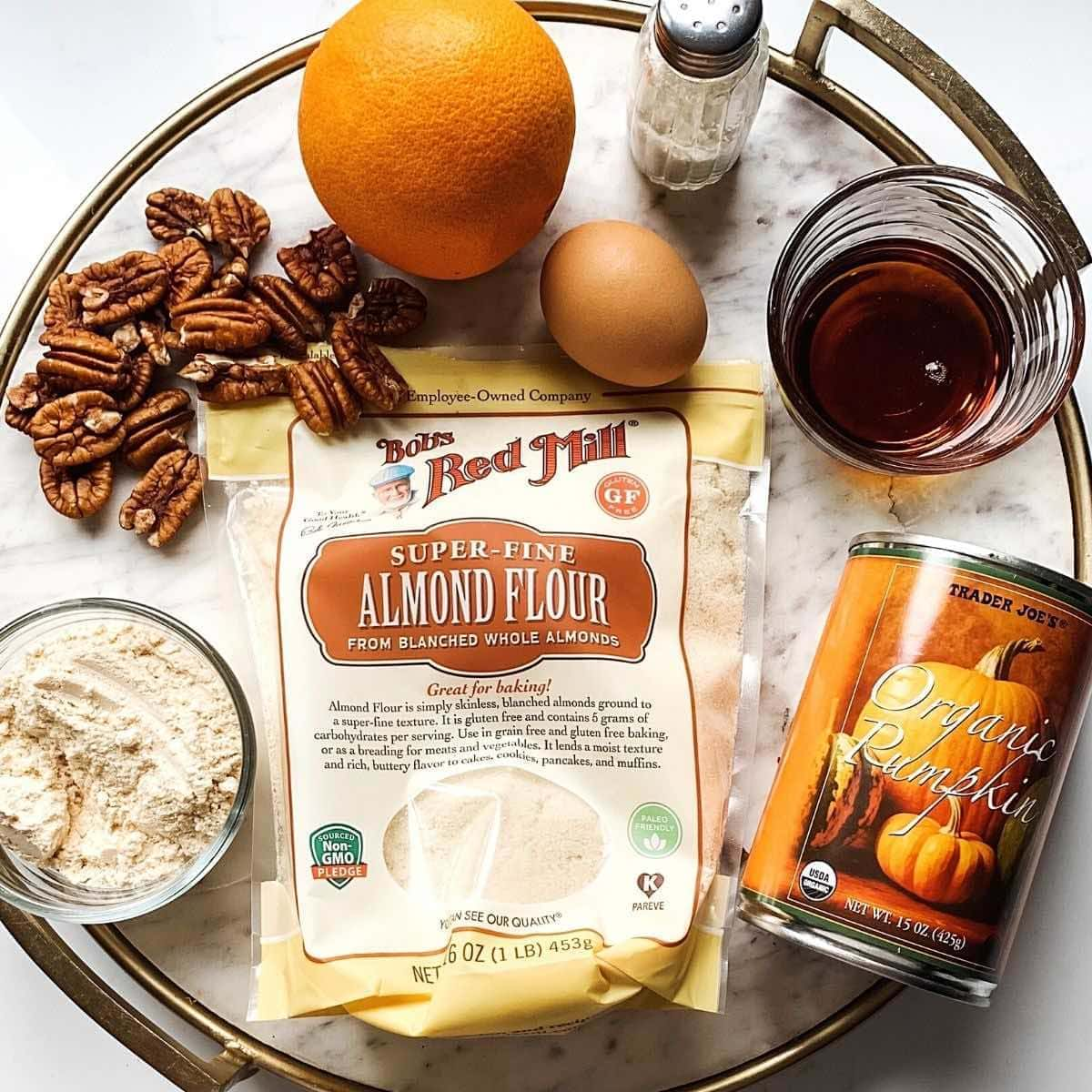 White marble tray with ingredients to make paleo pumpkin muffins.