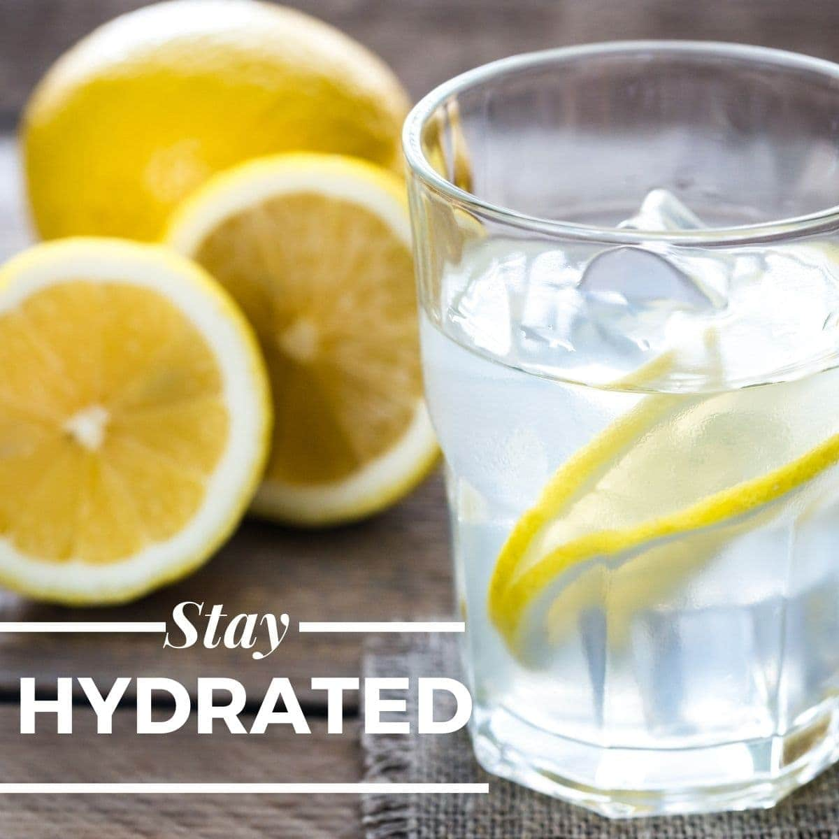 photo of a cup of water with lemon slices and text-stay hydrated.