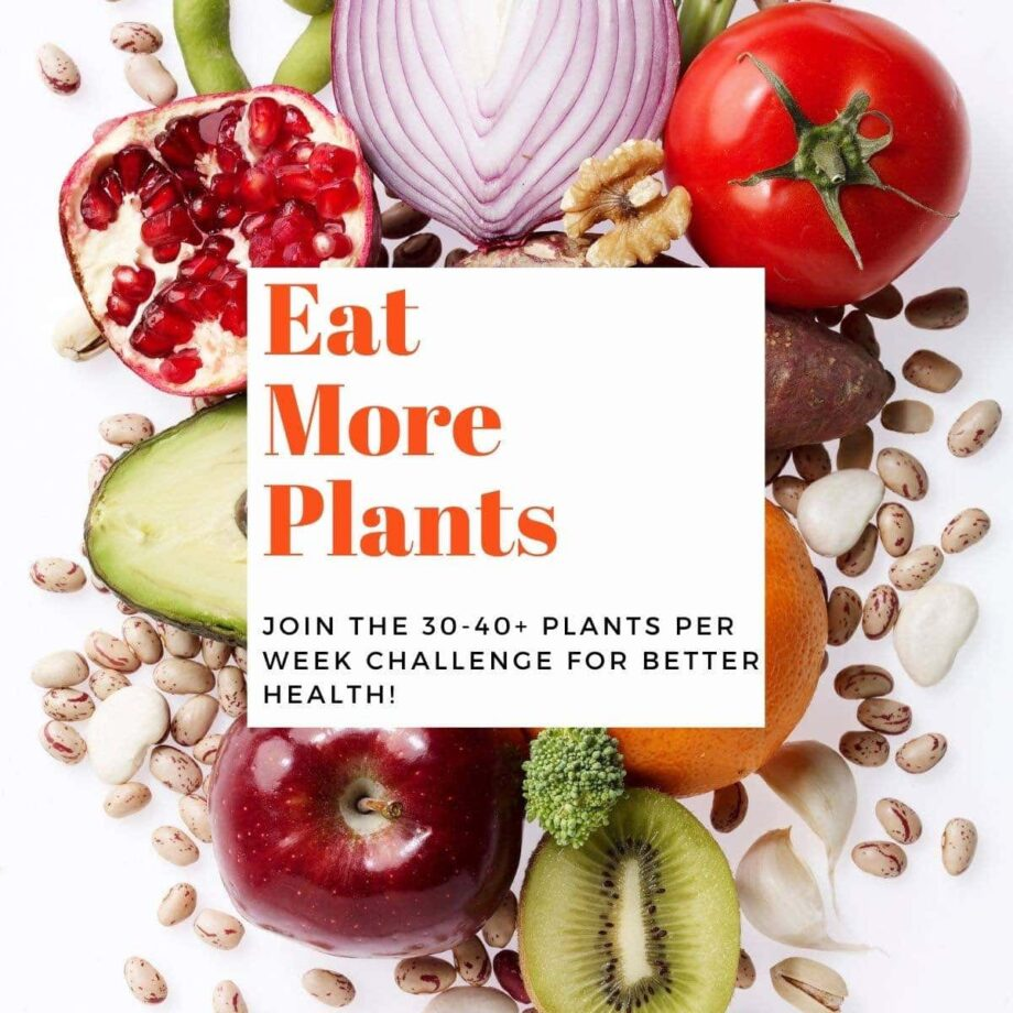 Colorful fruits and vegetables on a white background with text overlay-Eat More Plants.