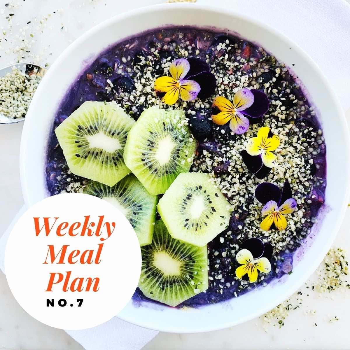 Bowl of blueberry smoothie with text overlay-weekly meal plan no 7.