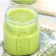 Photo of a green low FODMAP smoothie in a mason jar.