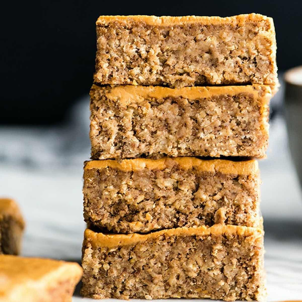 Plant-based breakfast recipes featuring a stack of 4 peanut butter breakfast bars.