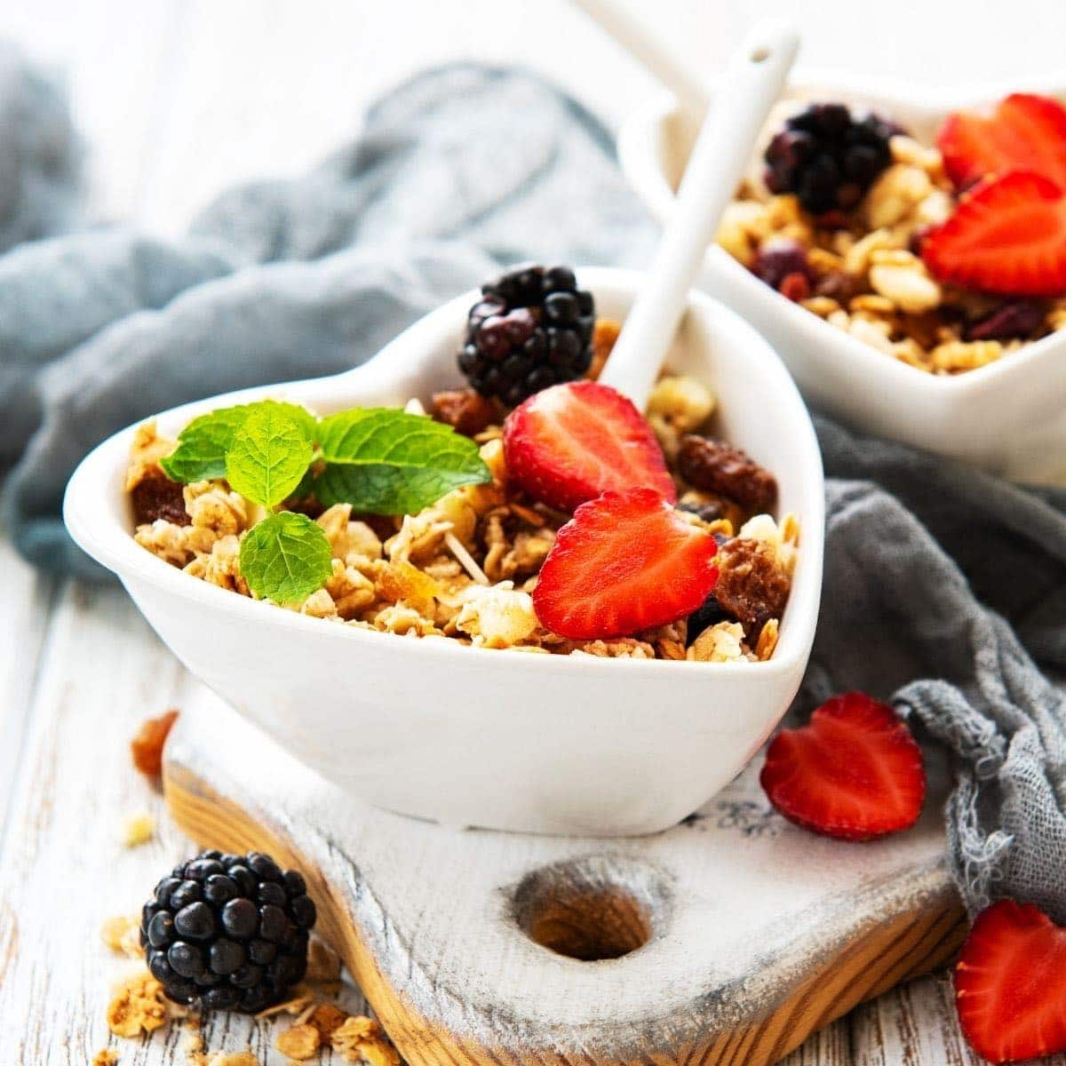 Plant-Based Breakfast Ideas with a heart shaped bowl of granola and fruit.