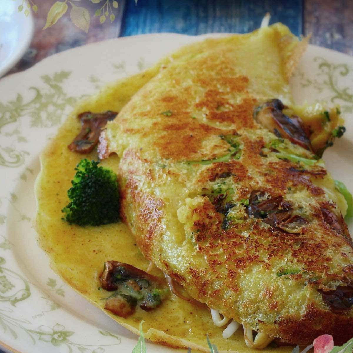Plant-based breakfast ideas featuring a savory vegan crepe with vegetables.