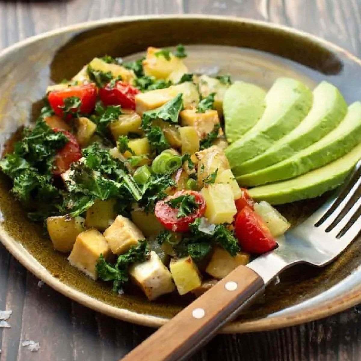 Plate of vegan sheet pan hash browns with tofu and veggies.