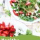 Two white plates topped with strawberry arugula salad and text overly-Weekly Gluten Free Meal Plan.
